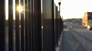 Inspiring shot of sunlight through railing in city 4k