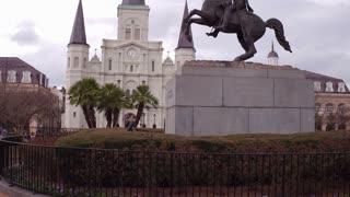 Jackson Square with statue and cathedral in background 4k