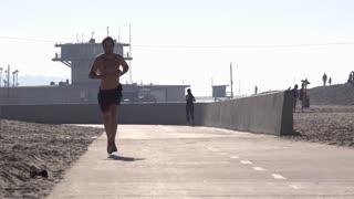 Joggers at Venice Beach enjoying morning workout 4k