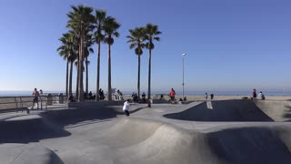 Kids at skate park in Venice Beach California 4k