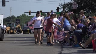 Kids passing out American Flags in July 4th Parade Fairborn Ohio 4k
