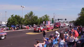 Large American Flag going by crowd in 4th of July parde 4k