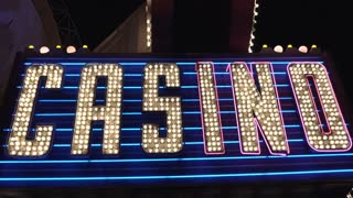 Large colorful casino sign flashing exterior of building 4k