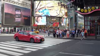 Large crowd of pedestrians crossing busy NYC streets 4k
