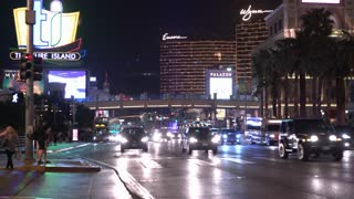 Las Vegas Boulevard strip of casinos at night with busy street traffic 4k