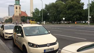 Line of Taxi cab drivers waiting on city street of Berlin