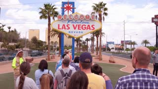 Line of tourists waiting to take picture at Welcome to Las Vegas sign 4k