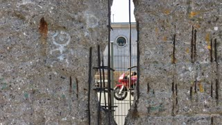 Looking through hole in Berlin wall memorial
