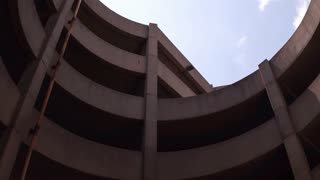 Looking up at parking garage in large city 4k