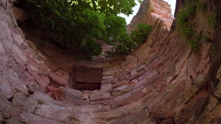 Looking up from bottom of castle wall pit 4k