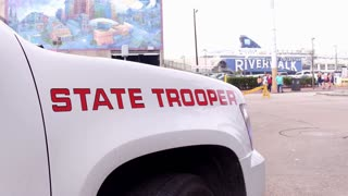 Louisiana State Trooper parked in front of Riverwalk during Mardi Gras 4k