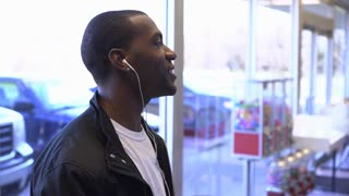 Man listening to headphones having conversation off screen 4k