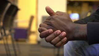 Man rubbing together hands in a nervous or worried manner 4k