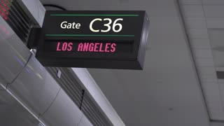 Man walking by departure gate for Los Angeles 4k