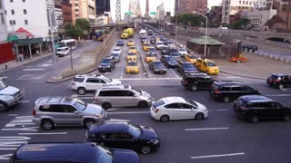 Manhattan traffic at busy intersection in NYC