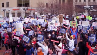 March for our Lives crowd holding up signs in Dayton Ohio 4k