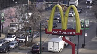 Mcdonalds sign along downtown intersection Chicago 4k