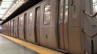 Metro train leaving station in downtown New York City 4k