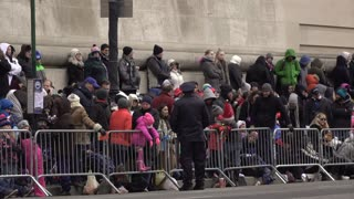 Morning Crowds along sidewalk of Macys Parade route waiting for the start 4k