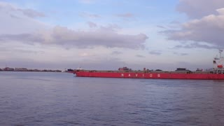 Navios Barge going down Mississippi River in New Orleans port 4k