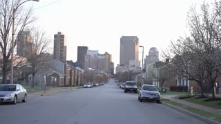 Neighborhood in downtown St Louis with city buildings in background 4k
