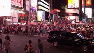 New York City tourists visiting popular Times Square at night 4k