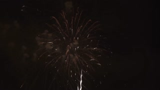 Night sky lit up by firework display 4k