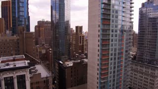 NYC building to street traffic establishing tilt shot
