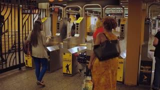 NYC Subway train customers going through turnstile 4k