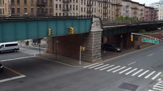NYC train passing by with city background establishing shot 4k