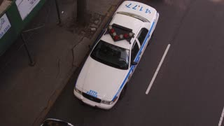 NYPD Police vehicle parked on side of street overhead shot