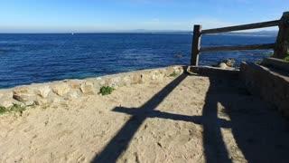 Ocean side view walking towards wooden fence