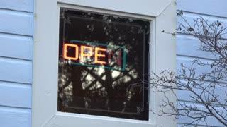 Open sign in local restaurant window flashing 4k