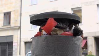 Overflowing trash can in city park 4k