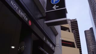 Parking entrance sign in large city 4k
