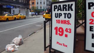 Parking sign in downtown city street of New York 4k