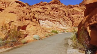 Path in Red Rock formations of Valley of Fire first person view