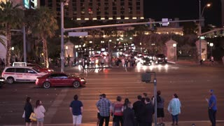 Pedestrian and street traffic on Las Vegas Boulevard at night 4k