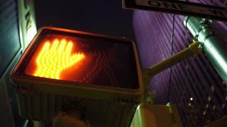 Pedestrian crossing light in big city evening hours 4k