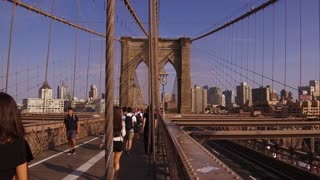 Pedestrians and tourists crossing over Brooklyn Bridge