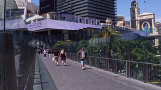 Pedestrians crossing bridge over Las Vegas Boulevard 4k