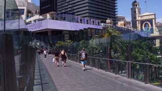 Pedestrians crossing bridge over Las Vegas Boulevard 4k
