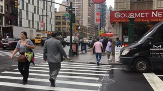 Pedestrians crossing busy intersection of NYC