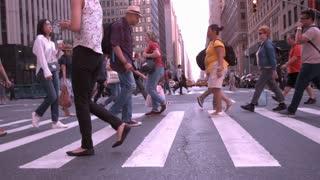 Pedestrians crossing city sidewalk slow motion NYC