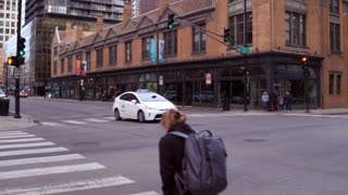 Pedestrians crossing city streets of downtown Chicago 4k