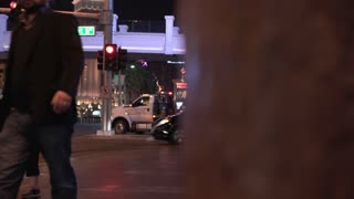 Pedestrians crossing intersection dolly reveal shot Las Vegas 4k