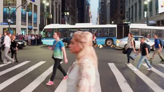 Pedestrians crossing New York City streets during busy evening hours 4k