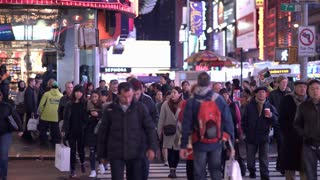 Pedestrians in Times Square crossing street 4k