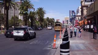 Pedestrians walking down main strip sidewalk in Las Vegas 4k