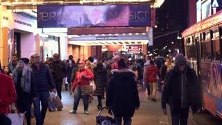 Pedestrians walking down sidewalk on Broadway NYC 4k